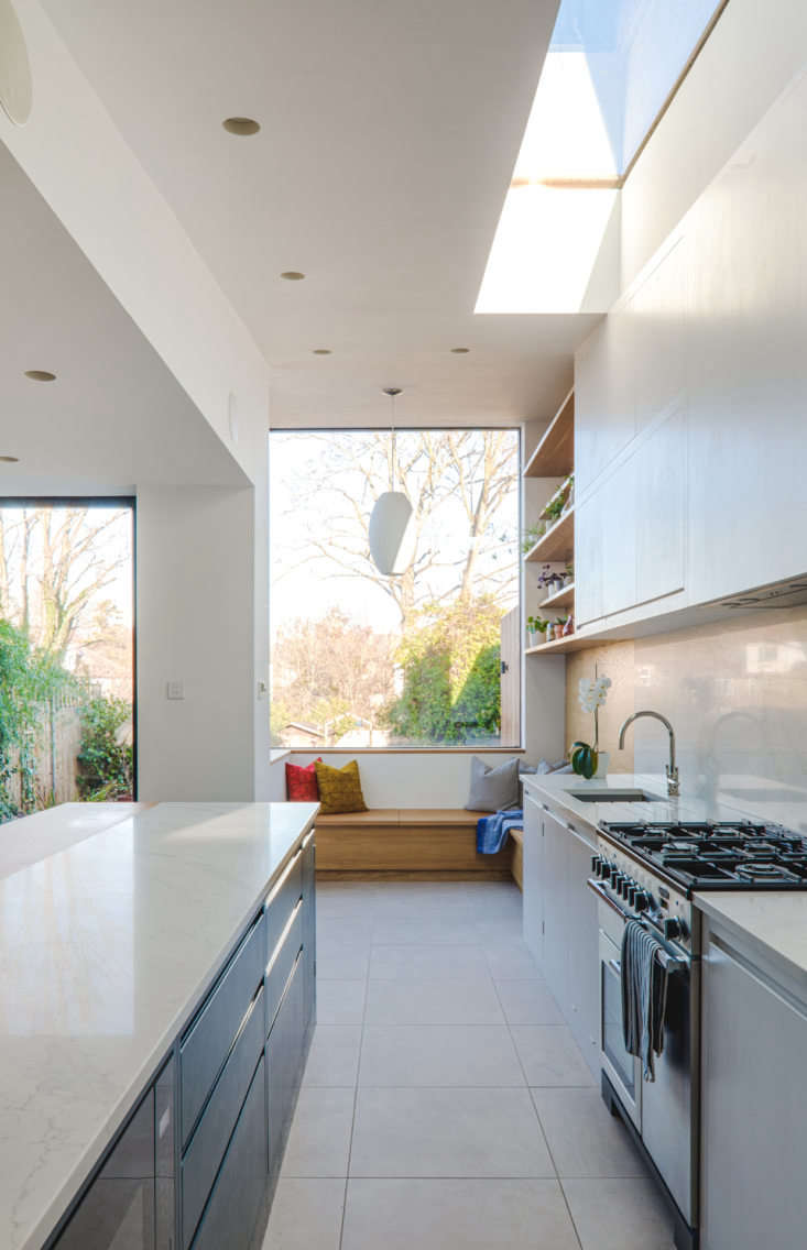 the extension is light filled thanks to a skylight, an oversized window, and a  9