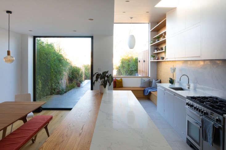 the floor to ceiling glass pivot door blurs the line between outdoors and in. 14