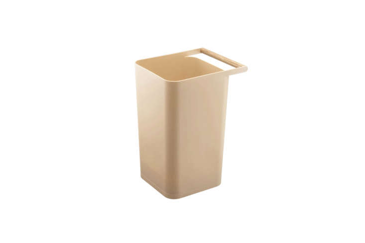 The Yamazaki Como Handle Wastebasket is made of sturdy but lightweight plastic and comes in a range of colors; $ at Yamazaki.