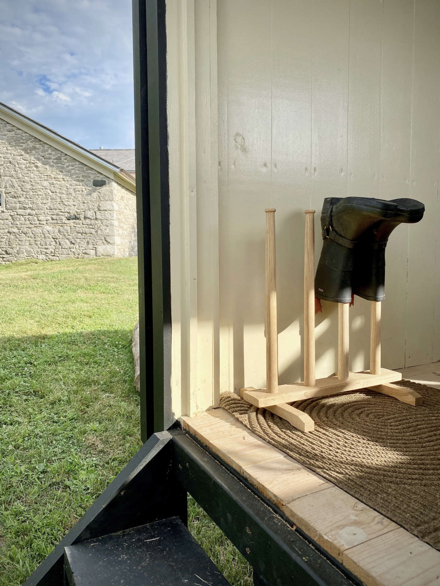 The Oak Boot Stand is another Minka offering (find more like it in our  Easy Pieces post Boot Racks for Wellies). The Sand Doormat evokes a Zen garden; it&#8