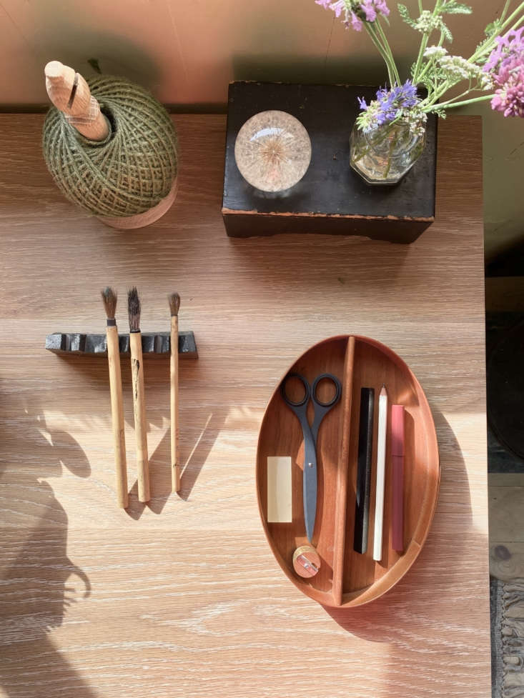 A Shaker caddy serves as a tidy desk organizer. The Oak Twine Stand is by Nutscene.