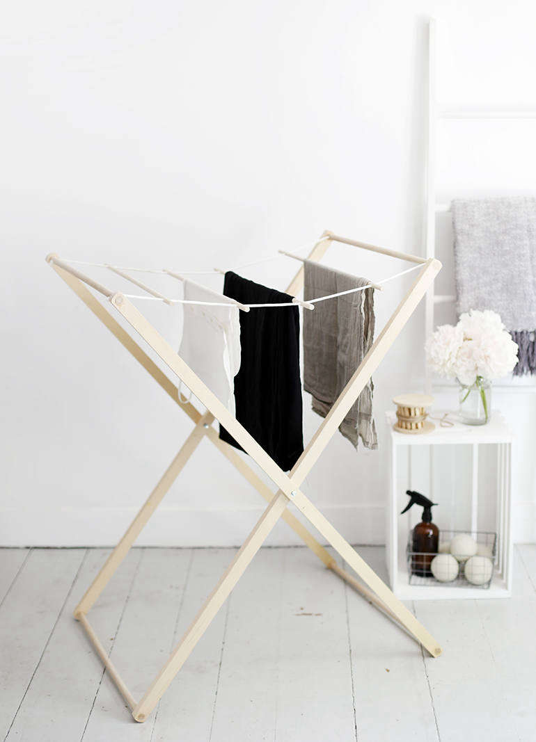 Manda made this DIY Drying Rack for her own family, and has been putting it to daily use for everything from dish towels to wet bathing suits. The hanging rods slide, so they can be spaced as needed.