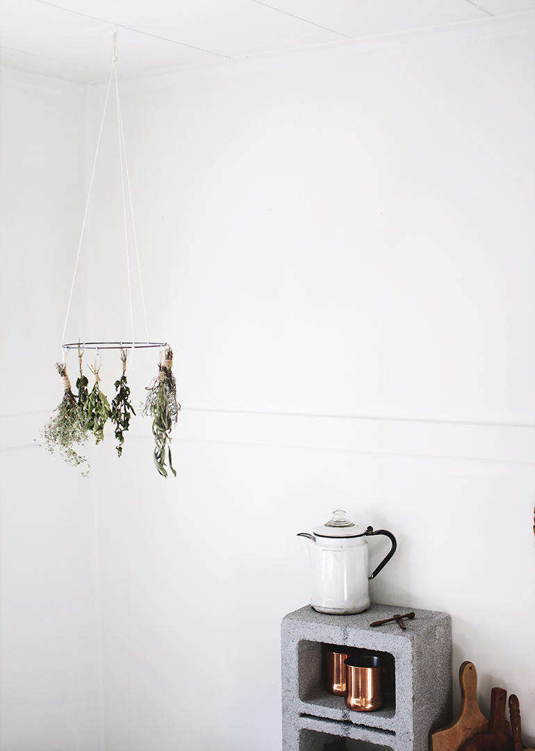 Make your own dried herbs using this DIY Herb Drying Rack. Caitlin put this one together using a hoop from a crafts store, but you can make own from a wire clothes hanger. Sage, rosemary, lavender, and lemon balm are some of the herbs she recommends for air drying.