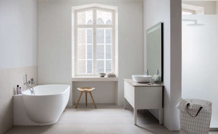 Currently Coveting Cecilie Manzs NordicSerene Bathroom Sinks and Tubs for Duravit The bathtub is also available in a back t0 the wall and corner version with a ledge. The console is shown here with a walnut counter; the top drawers are available with wooden dividers.
