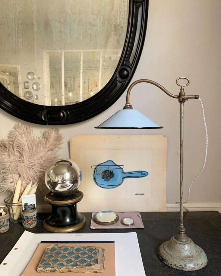 A collection of objets on a desk. (The periwinkle adjustable lamp is currently for sale.)