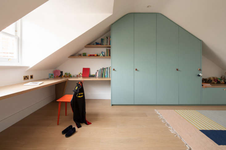 the other kid&#8\2\17;s room, fitted with custom cabinets built under the e 22