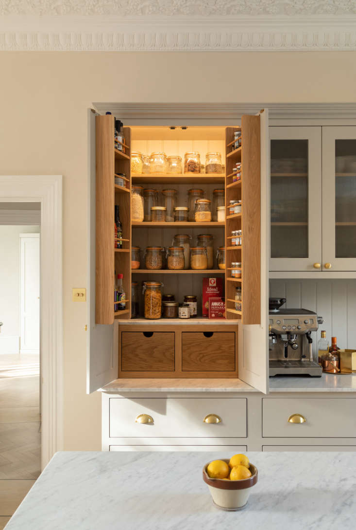 Pantry items are stored inside the hutch cabinet.
