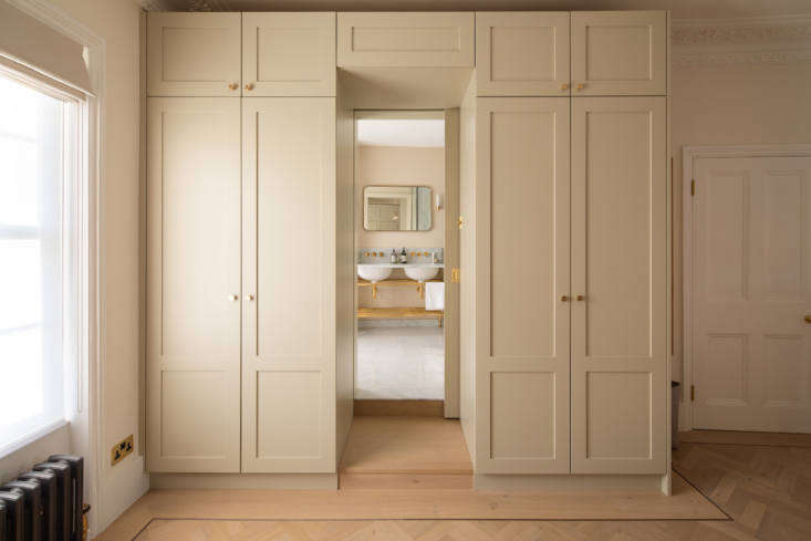 Two built-in closets create a short hallway to the ensuite bath.