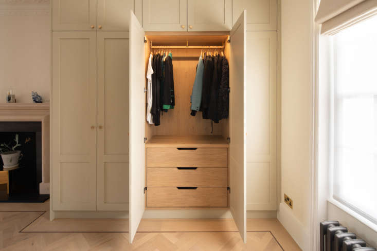 Opposite the bathroom is another built-in wardrobe set.