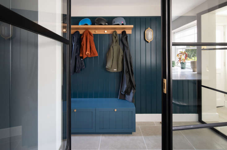 The mudroom, painted Farrow & Ball Stiffkey Blue, is on the basement floor, as are a laundry room and a family room/playroom.