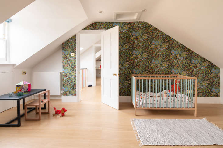 the kids&#8\2\17; rooms are on the top floor. here, wallpaper in the paradi 21
