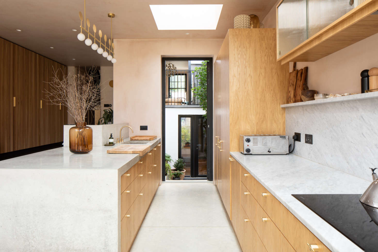 A steel and glass door opens into the interior courtyard.