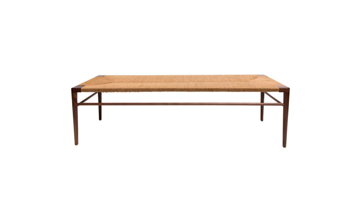 The rush bench in the space is from Japan. For a similar look, try this American-made Woven Rush Bench by Mel Smilow; $3,060 at src=