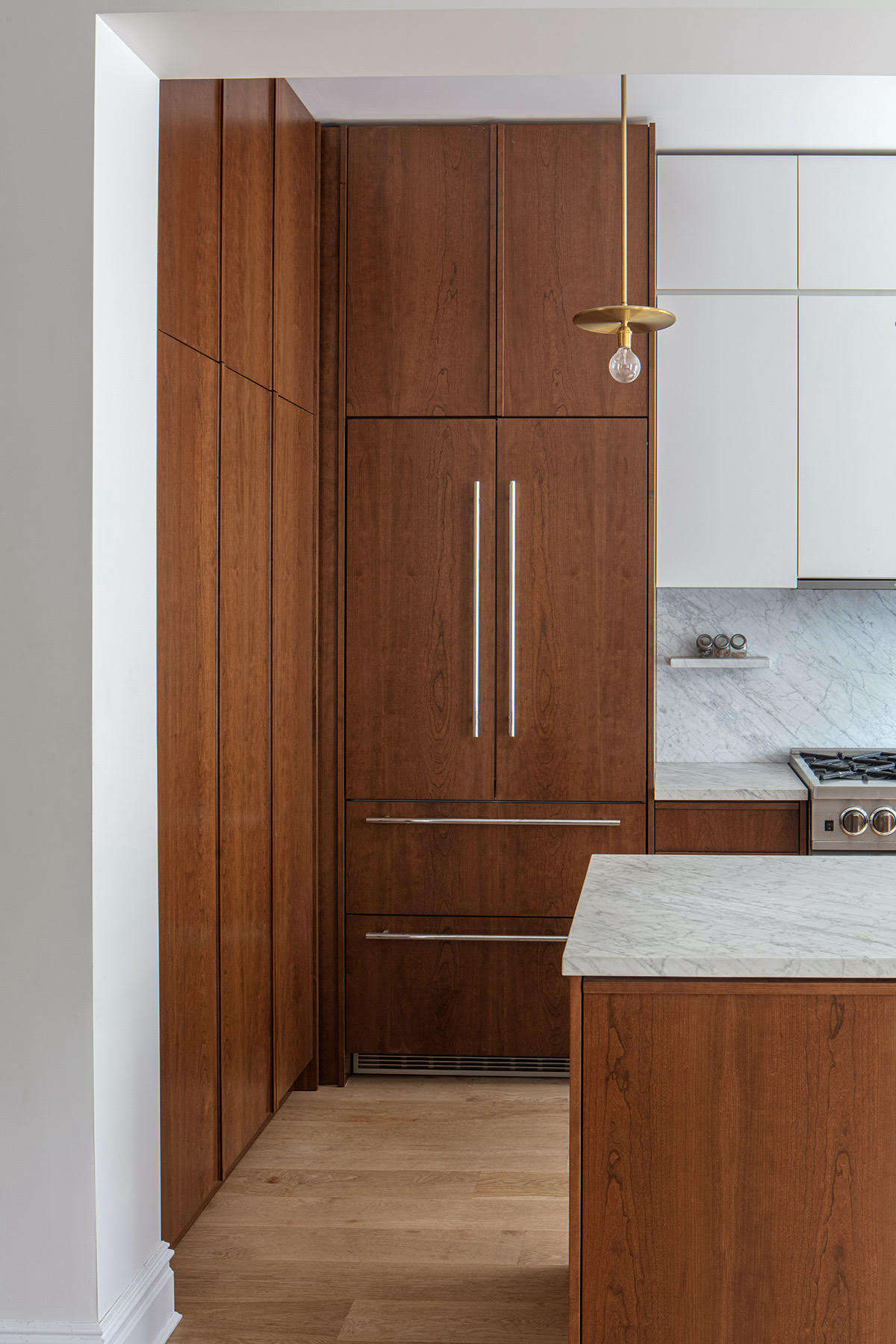 The fridge is a 36-inch-wide, panel-ready Liebherr.