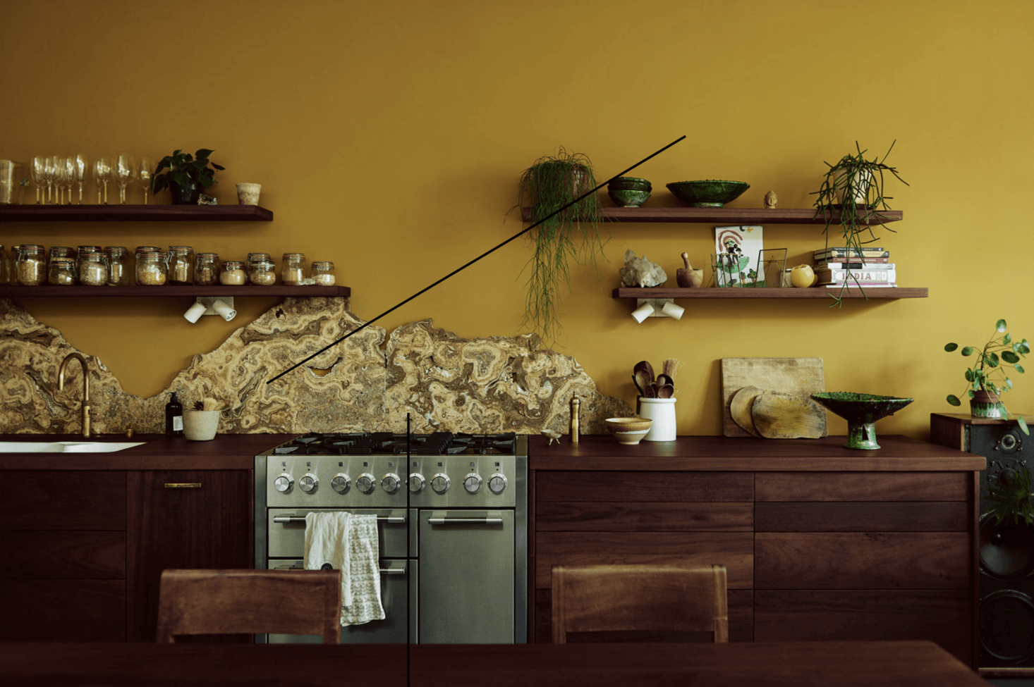 Salvage specialists Retrouvius of London used a natural stone backsplash in this West London kitchen. Go to Masters of Salvage to see another standout remodel of theirs. Photograph by Michael Sinclair.