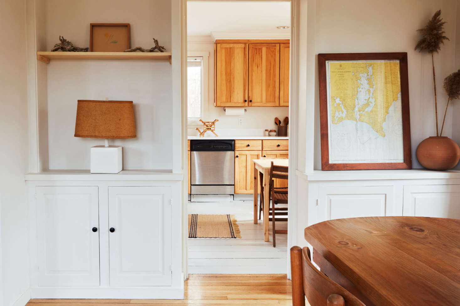 Built-ins divide living room from kitchen. On the shelves, says Sean: &#8