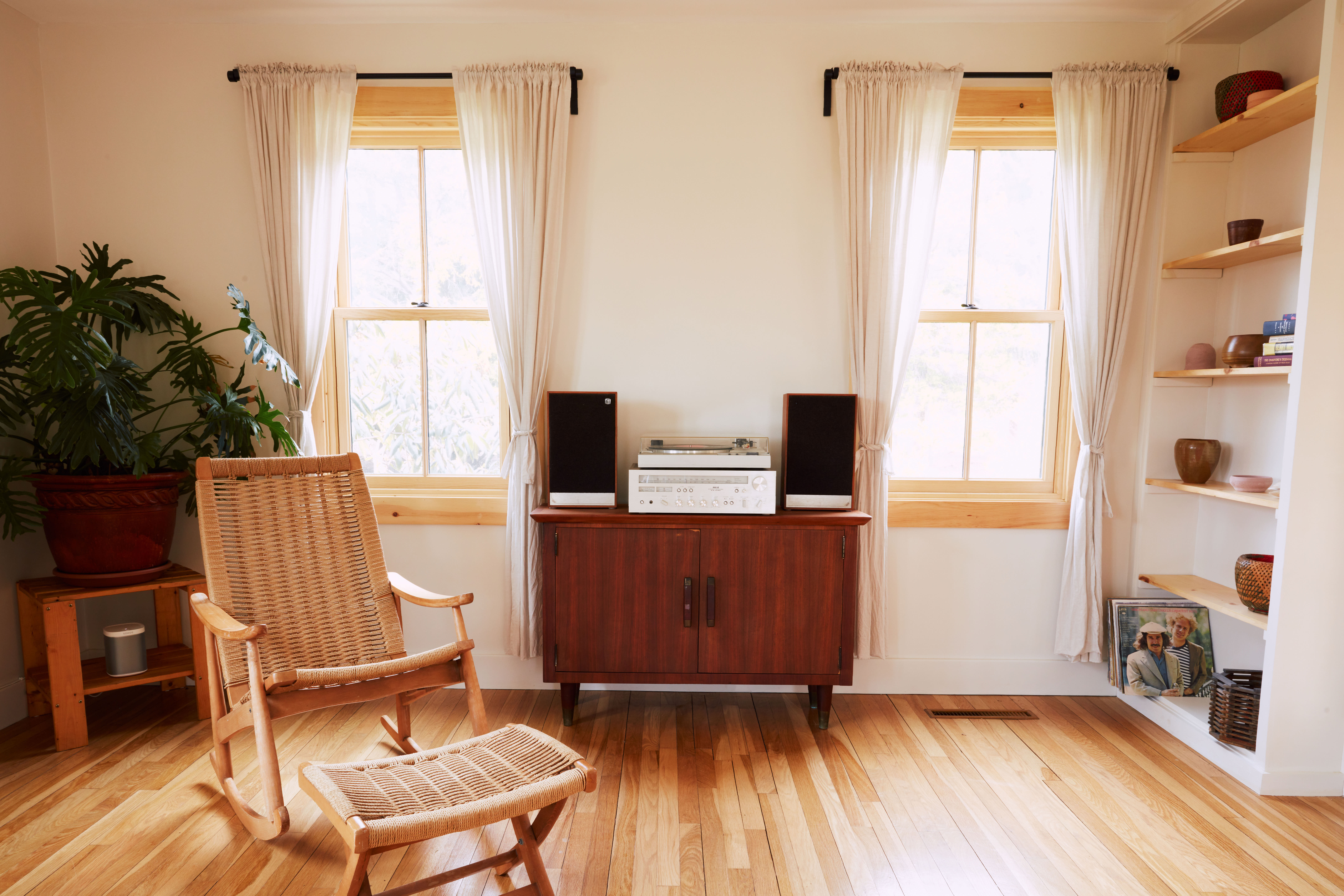 Summer Sounds A Pair of Musicians Effortlessly Cool Redone Cape in Westerly RI Available on Airbnb In the living room, what Sean calls the &#8\2\20;listening station.&#8\2\2\1; The turntable and speakers are vintage, the stand is from an estate sale, and the couple found the rocker on Facebook Marketplace.