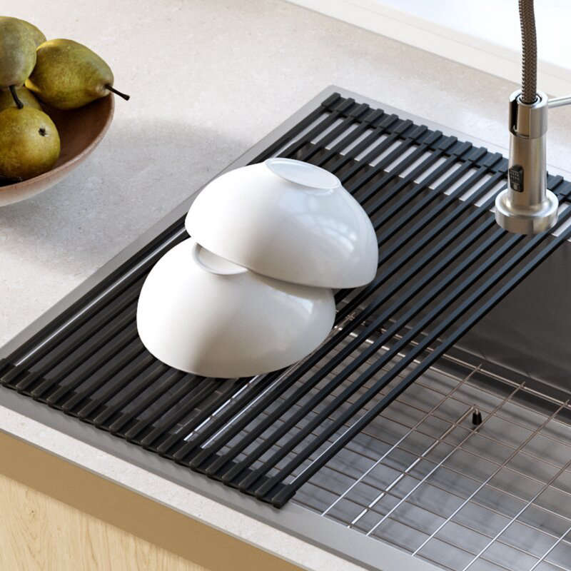 The Stainless Steel Over the Sink Multipurpose Roll-Up Drain Tray by Kraus is $.95 from Wayfair.