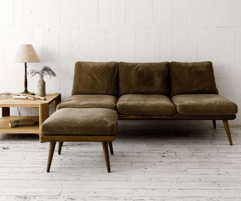 Katie selected the CS Sofa and Ottoman from Truck in Japan for the living room; ¥594,000 and ¥5,500.