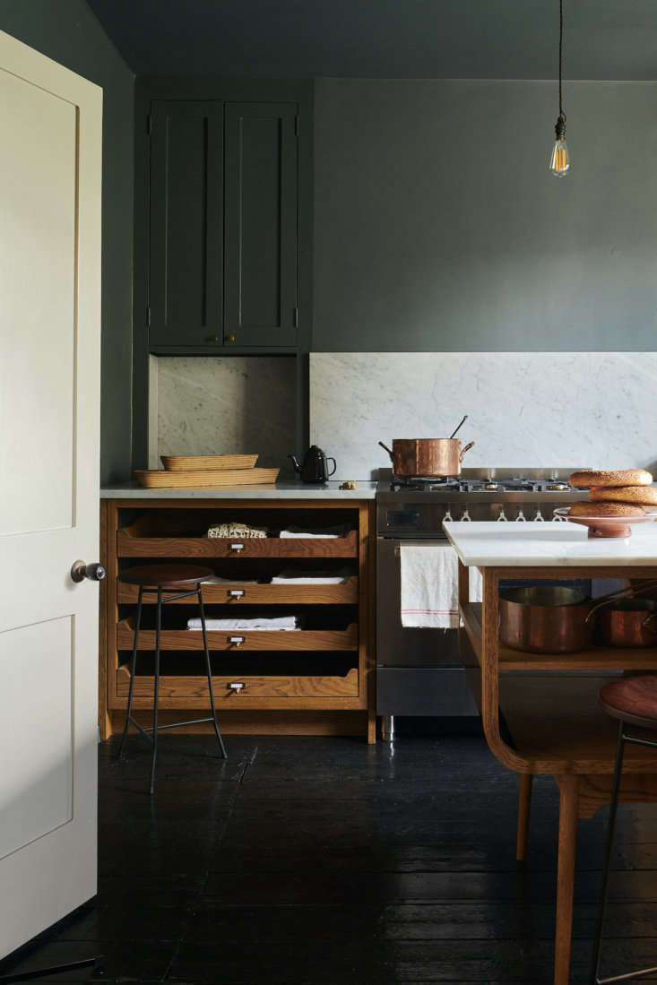 The midcentury-style oak cabinets, the company&#8