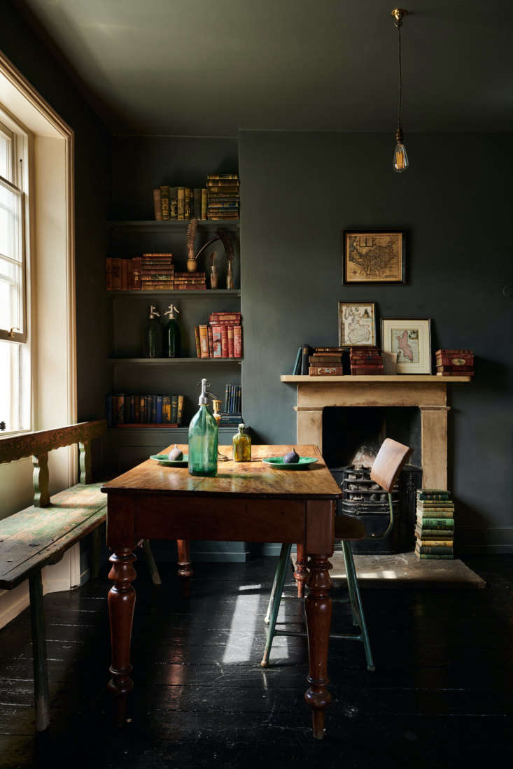 As in many of deVOL kitchens, Farrow & Ball paints play a prominent role. The walls are Down Pipe; the doors and trim Drop Cloth. The original floors have been painted a glossy black.