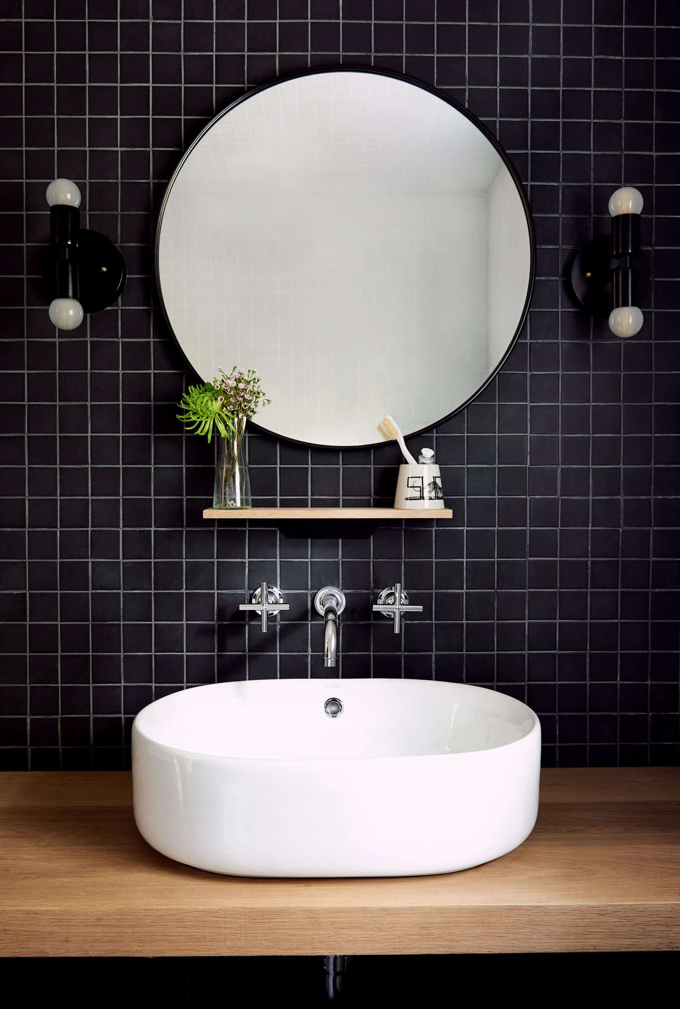 Unpolished black mosaic tiles from Daltile were used for an accent wall in the bathroom. The