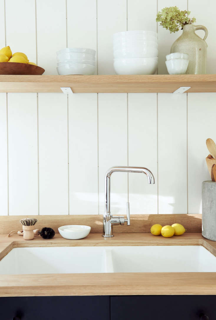 The white oak countertop and shelving was made by his best friend from elementary school.