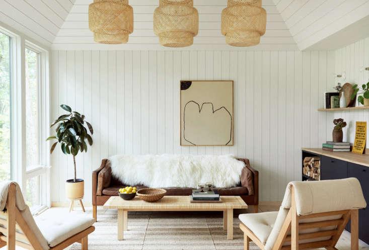 The Scandi-inspired interiors feature Ponderosapine shiplap wall paneling, painted Sherwin Williams&#8