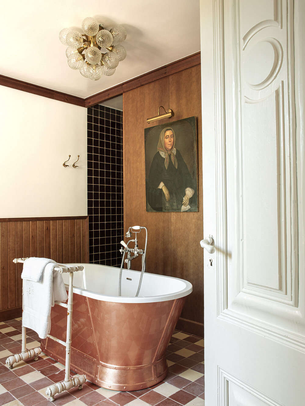 A copper tub in the Valentina suite. The historic portrait, Pol says, is emblematic of the whole design: &#8
