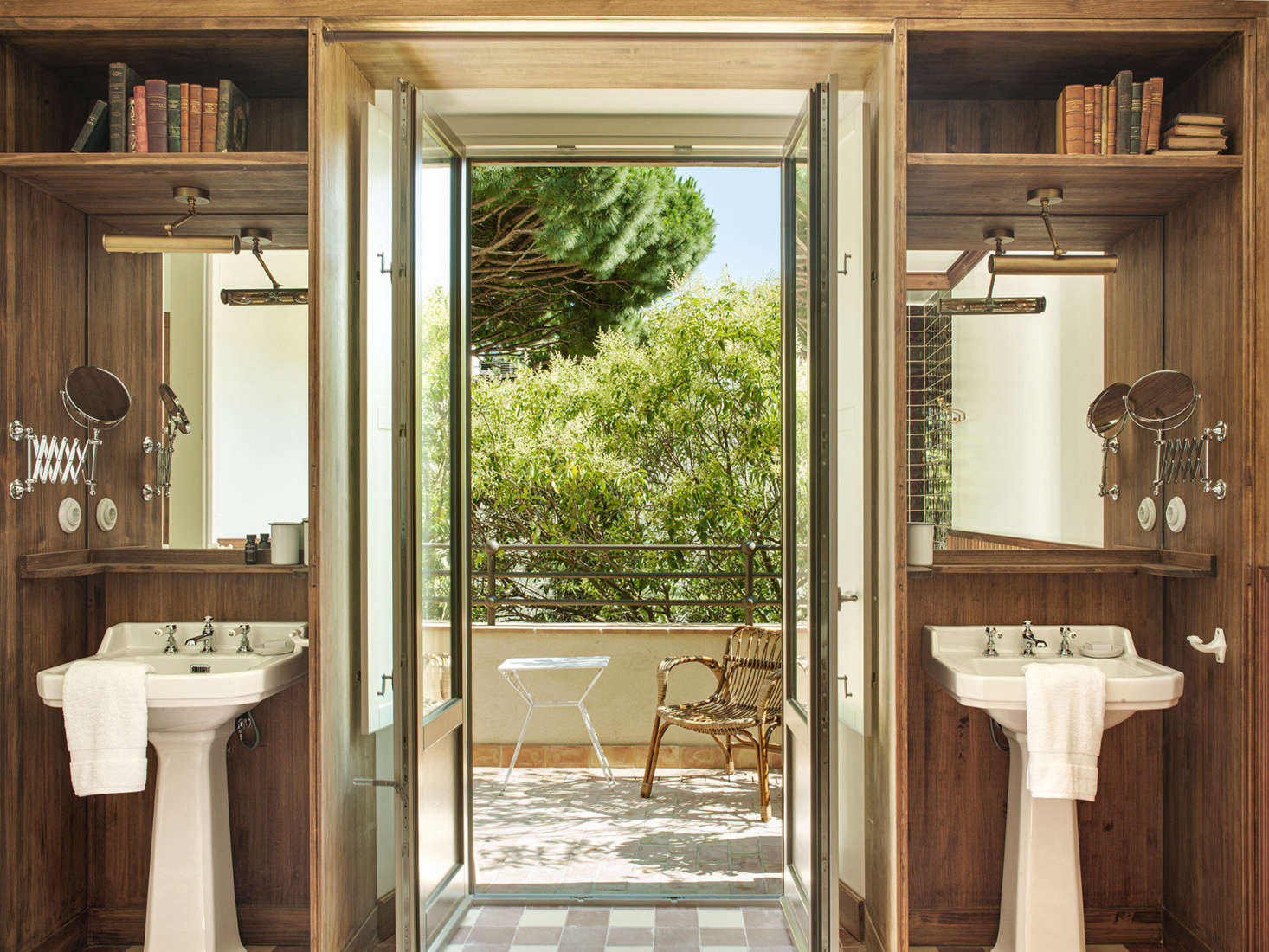 In the Valentina suite, twin sinks flank the door to a private patio.