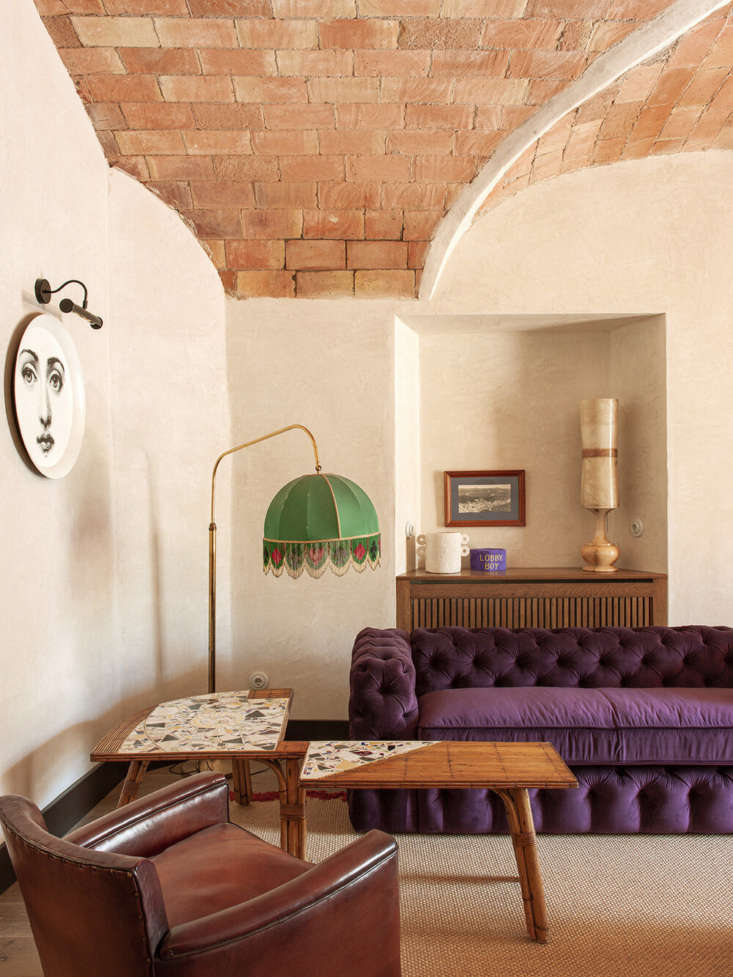 La Bionda Hotel in Spains Costa Brava A Romantic Reuse Project by Quintana Partners &#8\2\20;Wes Anderson&#8\2\17;s Grand Budapest Hotel was an inspiration for a lot of the design details,&#8\2\2\1; says Pol—such as the lobby&#8\2\17;s locally made Chesterfield sofa (in a velvet from Güell Lamadrid, fireproofed per local regulations) and Lobby Boy hat. Note the Fornasetti tray hung as art. The fringed lampshade is the first of many.