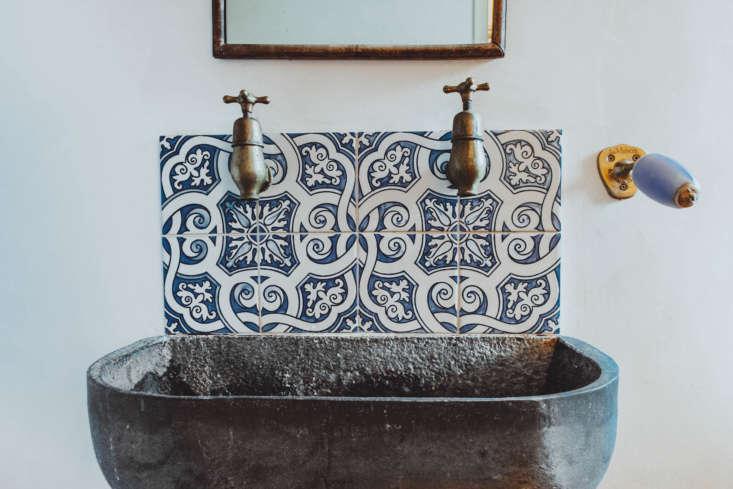 Also beside the sink: a wall-mounted soap holder by La Maison du Savon de Marseille.