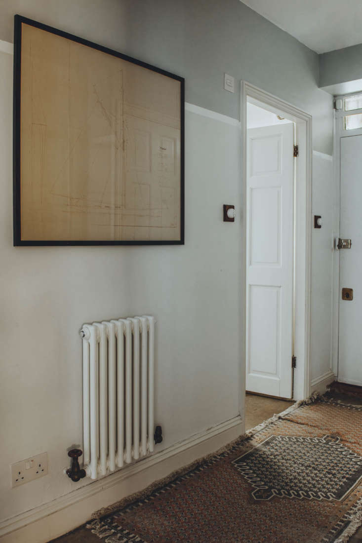 The hallway, layered with antique rugs.