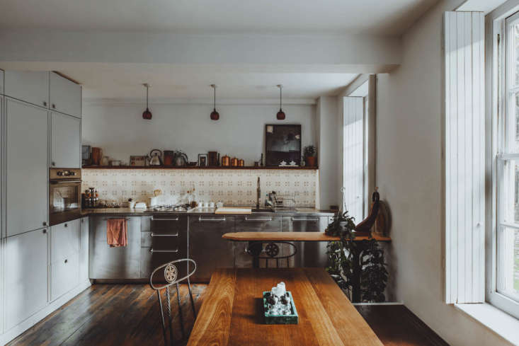 All Things Should Have Stories A Richly Hued London Flat With an Ikea Kitchen Too The kitchen fills one end of the main room. &#8\2\20;The stainless steel kitchen front is Ikea, believe it or not,&#8\2\2\1; writes Lionel. &#8\2\20;We then got a bespoke stainless steel top made for us, as that had been my childhood dream to have a commercial feeling kitchen.&#8\2\2\1; The room feels far from cold, though, balanced out as it is with dark wood hues, soft white walls, and a shelf holding copper canisters, a kettle, and art.