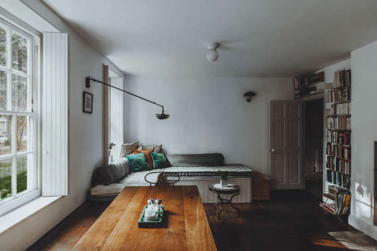 All Things Should Have Stories A Richly Hued London Flat With an Ikea Kitchen Too The living area, with a built in place to read or look out the window and French made Wo and Wéwall lights. There&#8\2\17;s storage beneath the seating, too.