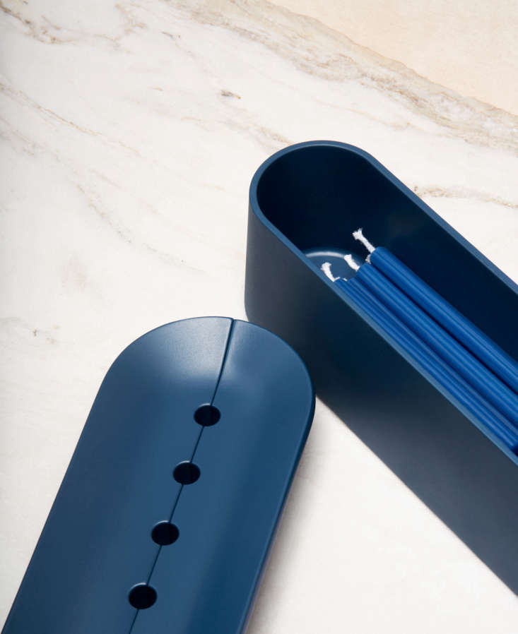 the candleholder comes in four finishes, including midnight, all made of alumin 12