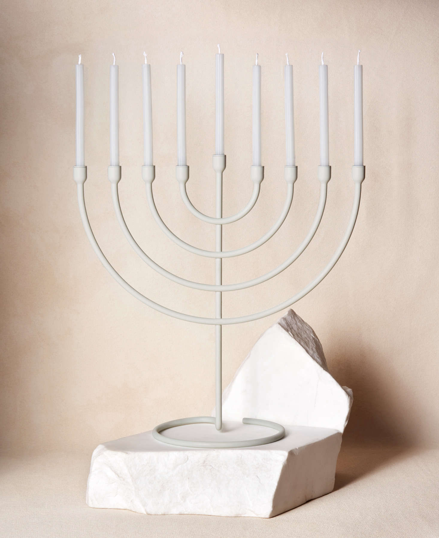 """The Trace Chanukiah, $5, is made of steel and comes in five colors. It holds eight candles, one for each night of Hanukkah, but can also be used throughout the year: """"We were thinking about how each item is a design piece for the home, not something that lives in a closet most of the time,"""" Schwartz told Vogue."""