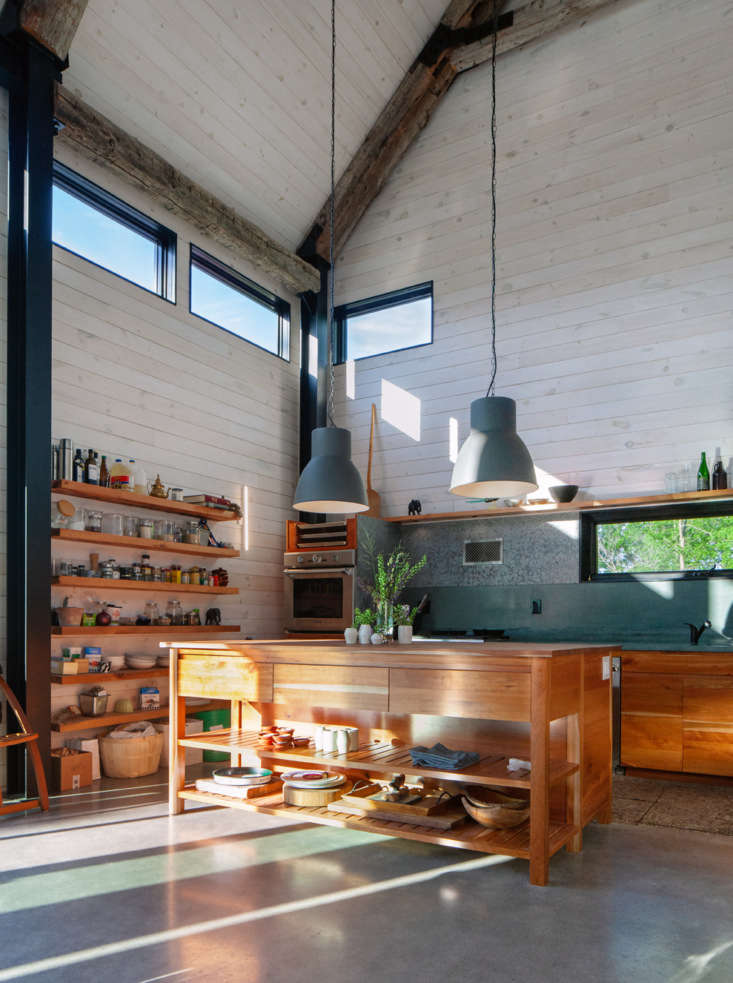 the kitchen cabinets, island, and shelves are custom made from salvaged cherry  11