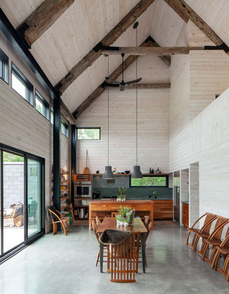 the open space in the addition features polished concrete floors, white washed  10
