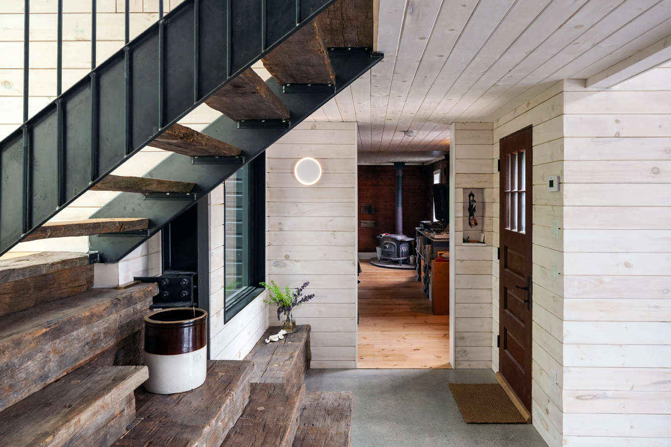 The entrance to the home. The stairs are made from the same reclaimed wood as the ceiling beams.