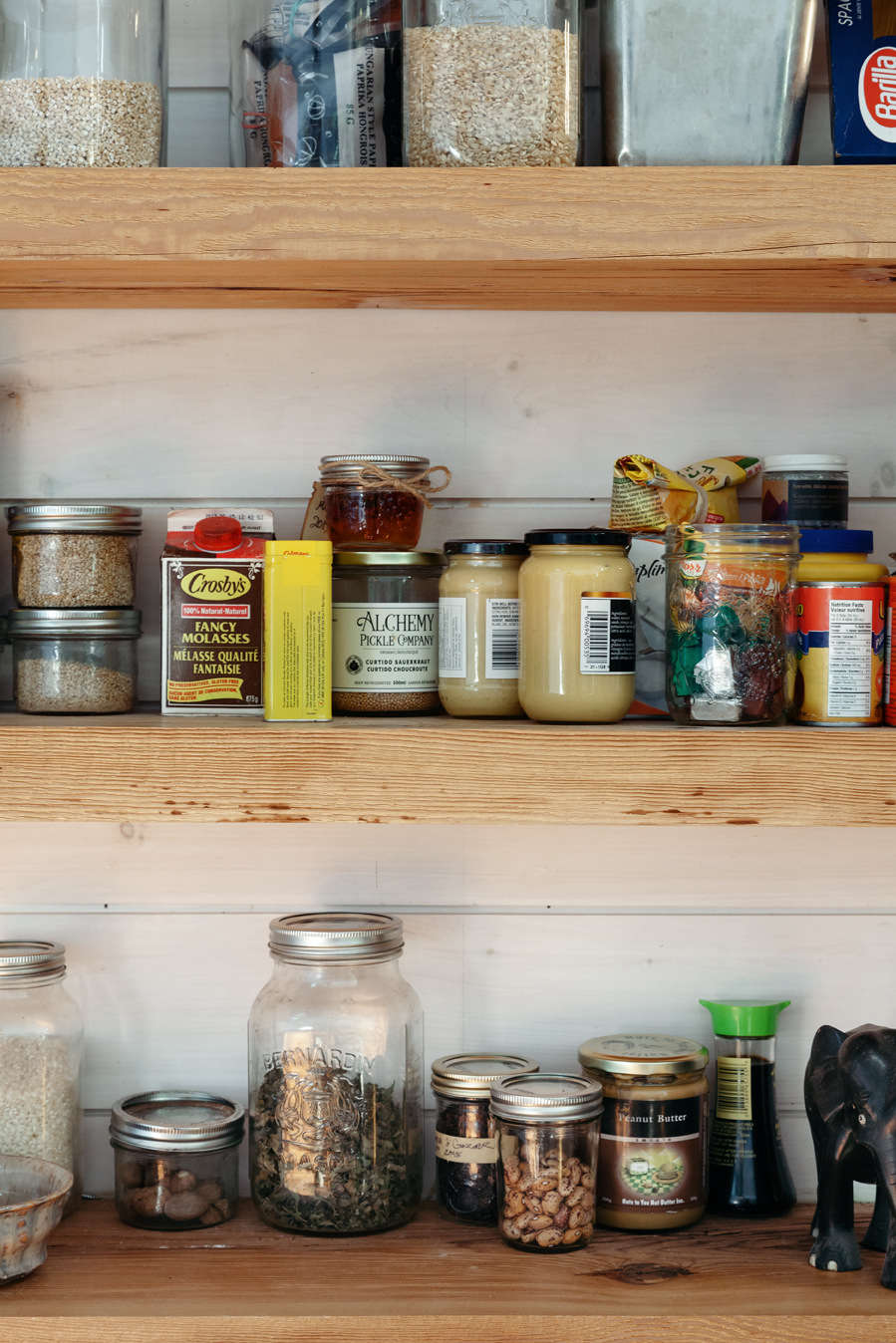 A peek at the various pantry items stored on the open shelves for easy access.
