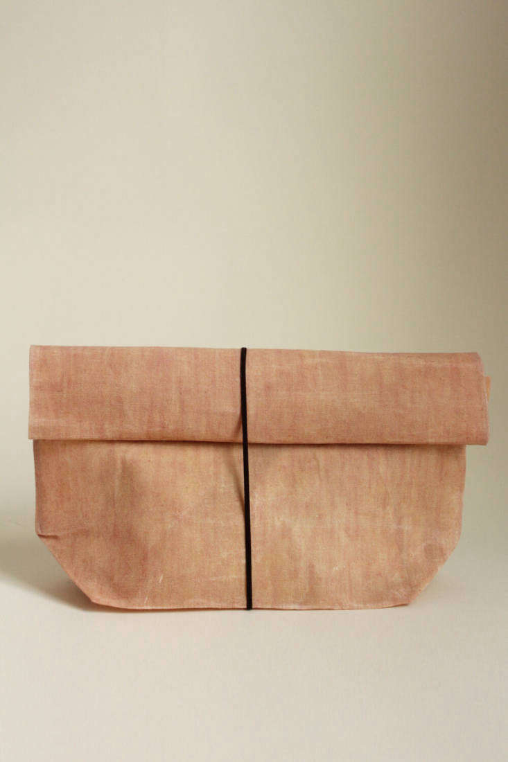 The Waxed Linen Roll-Top Bag (£) is hand-dyed with flower heads and roots; ideal for use as lunch bags or to store bread,  grains, root vegetables, and more.