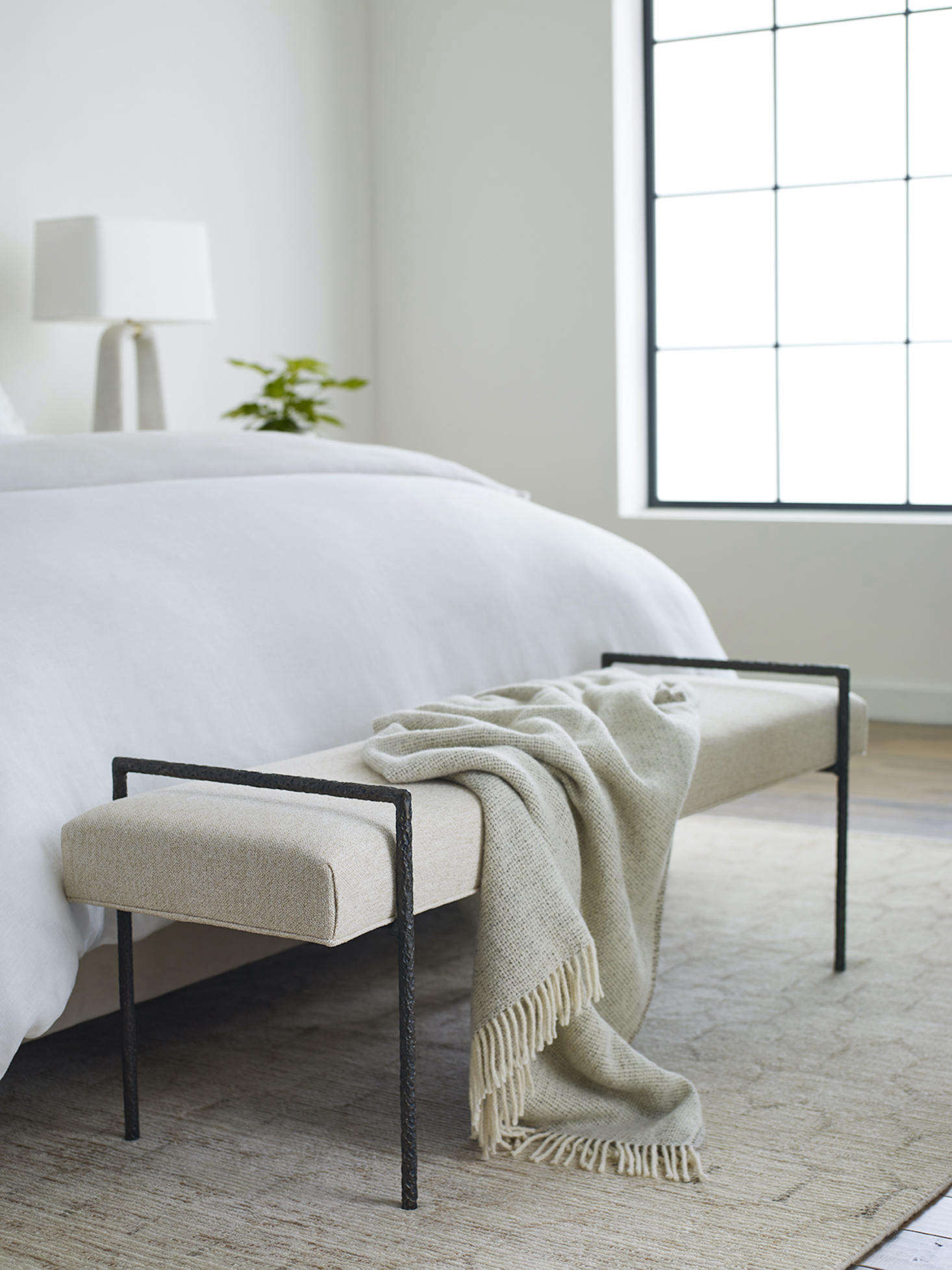 And the Yves Bench is a tribute to the centuries-old craft of blacksmithing, with a hand-forged, one-of-a-kind wrought-iron frame handmade by metalsmiths in the Blue Ridge Mountains. Its uses are many, from a sitting spot at the end of a bed or in a living area to a place to put on shoes in an entryway.