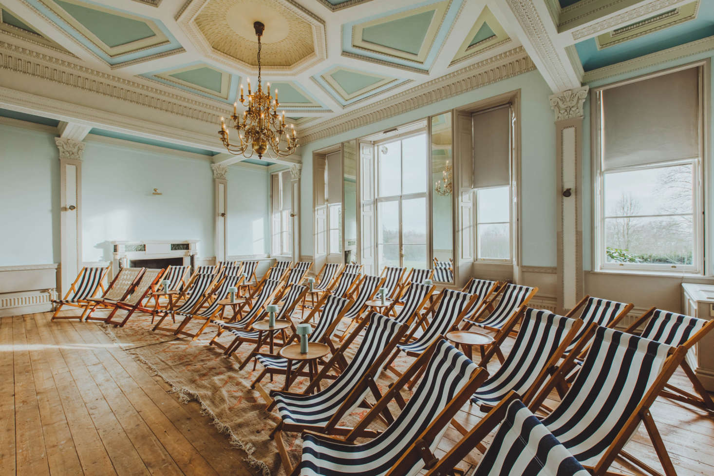 The screening room has rows of striped canvas deck chairs.
