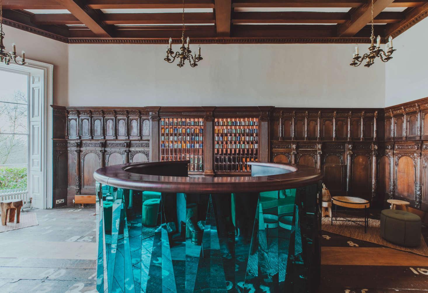 The reception area has a sculptural metal-clad concierge desk.