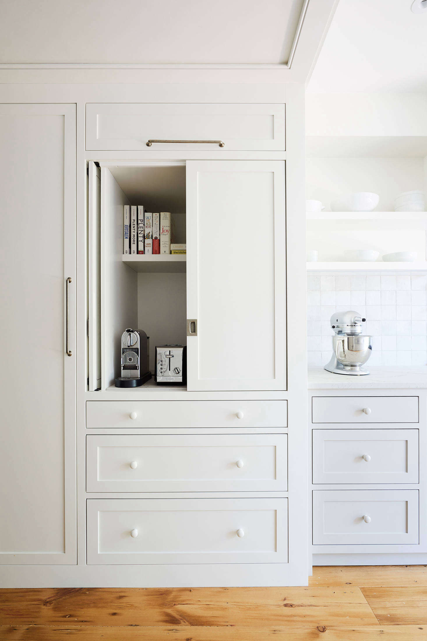The cabinets have pocket doors and plenty of space for appliances and cookbooks. Report the owners, &#8