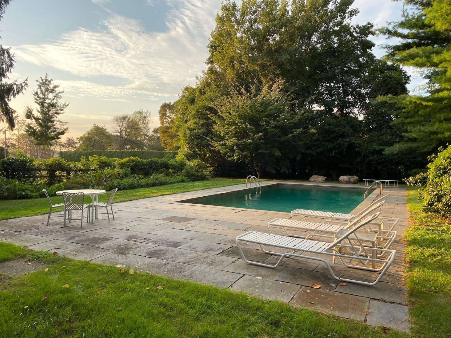 The pool is surrounded by bluestone paving.