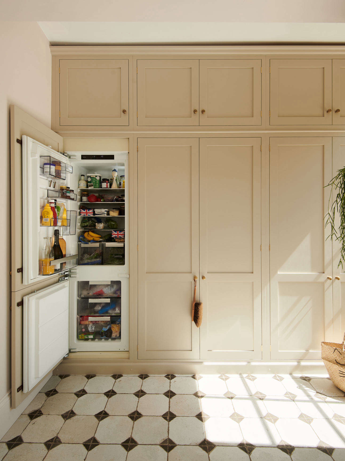 Just off the main kitchen area is a wall of cabinets, painted in deVOL&#8