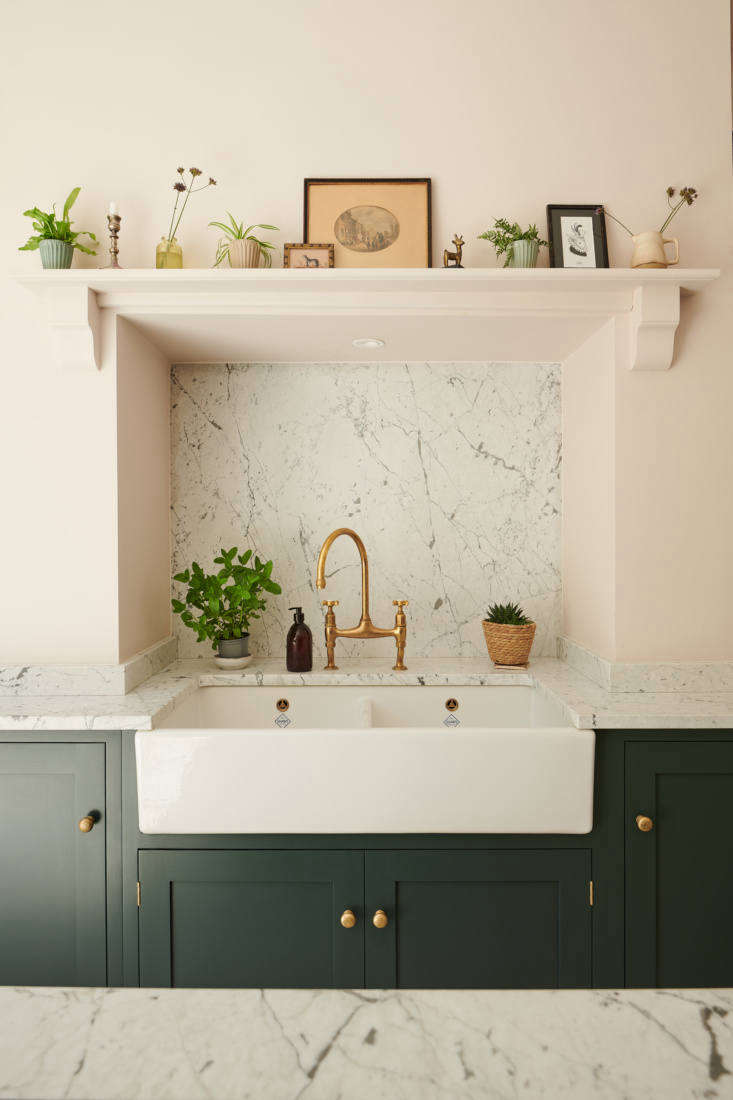 Another unique design decision: inserting the sink into a chimney breast. The cabinets are from deVOL&#8