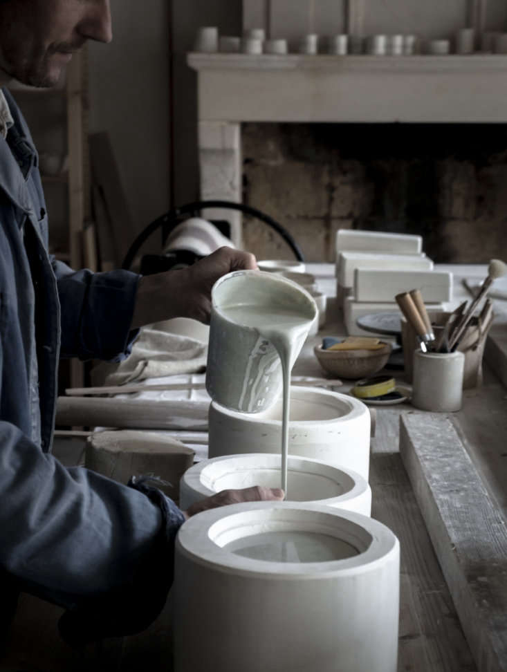 jean pours liquid clay into a slip cast mold for a cup. epure is currently just 23